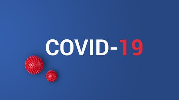 Iinscription COVID-19 on blue background with red ball